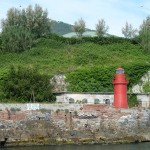 Photo of northern Italy - a small red lighthouse